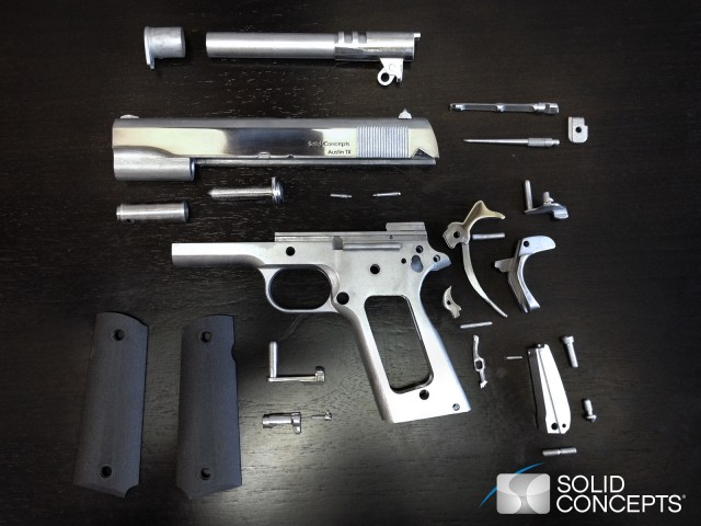 3D printed M1911 pistol, broken down into parts