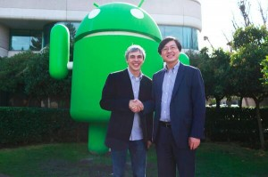 Google CEO Larry Page and Lenovo CEO Yang Yuanqing after they agree to the sale of Motorola Mobility to Lenovo