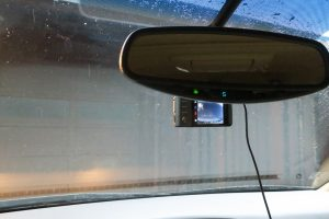 One issue with using a dashcam for safety is that best placement is high on the windshield -- that can make it hard to see the display behind the rearview mirror