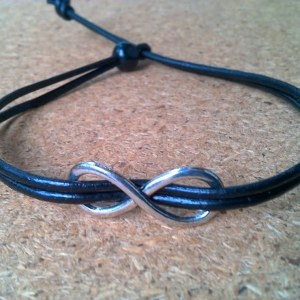 Handmade leather bracelet with infinity pendant