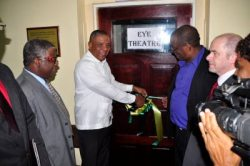 Minister of Health Horace Dalley (left) sharing in the ribbon-cutting at the opening of the upgraded eye care facility with chief executive officer of the Caribbean Council for the Blind Arvel Grant (third right). Also pictured are senior medical officer at the Mandeville Regional Hospital, Dr Everton McIntosh (left), programme monitoring advisor at Sightsavers) Phillip Hand, and medical officer of health within the Southern Regional Health Authority Dr Beverley Wright (partially hidden).