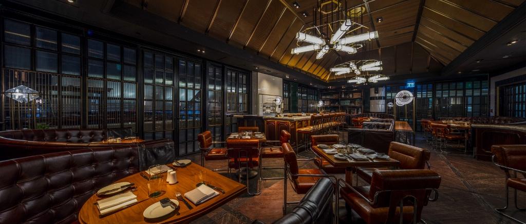 living room restaurant abu dhabi glass shelf unit cafe milano and butcher still open at four seasons hotel al maryah island