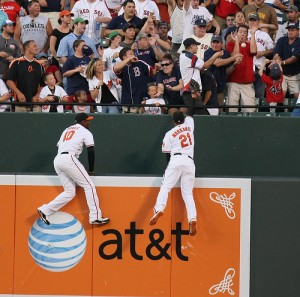Adam Jones (L) and Nick Markakis (R) demonstrate why they deserve a Gold Glove.