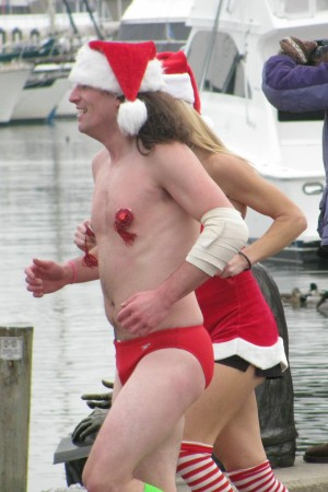 Tassles grace the chest of a nearly naked Santa in Annapolis