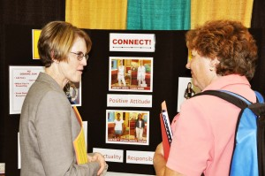 Marcia Hall, left, talks with a prospective job seeker at last fall's fair on the importance of good presentation when applying for jobs. Hall runs Reputation Counts, a company that provides training seminars on ways job seekers can boost their soft skills that demonstrate character, reliability and professional competency to help them attain and keep positions.