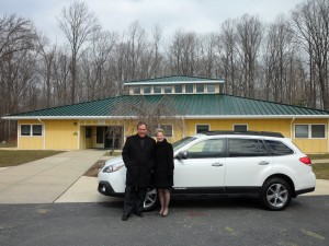 Mr. Frank Ferrogine, Annapolis Subaru and Dr. Jane Snider, Founding Executive Director in front of The Summit School.