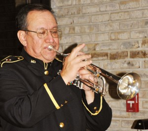 A bugler sounds taps at a past Veterans' Day Ceremony.