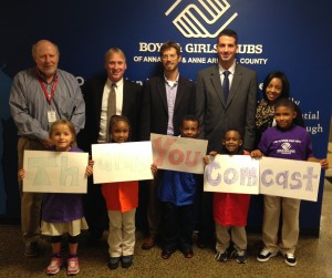 The Boys & Girls Clubs of Annapolis recently received a $20,000 grant from the Comcast Foundation to support their Club Tech program. Club Tech aims to make technology accessible, intriguing and fun through a broad range of supervised workshops that will give Club members basic computer skills. Pictured (l-r) Pete Ponne, board member and Interim Chief Professional Officer, Boys & Girls Clubs of Annapolis & Anne Arundel County; Chris Comer, Director, Government Affairs, Comcast; The Honorable Chris Trumbauer, Anne Arundel County Councilmember, Brad Palazzo, Director, External Affairs, Comcast; and Tierra Snowden, Director of Program Operations, Boys & Girls Clubs of Annapolis & Anne Arundel County with children from the club.