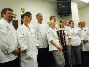 Team Anne Arundel, the culinary competition team of the Hotel, Culinary Arts and Tourism Institute at Anne Arundel Community College, took second place in the 6th Annual Chesapeake Culinary Cup competition held recently at Anne Arundel Community College's Hotel, Culinary Arts and Tourism Institute in Glen Burnie. Carrie Svoboda of Stevensville is holding the second-place trophy. From left are Chef David Ludwig, CEPC, CHE, Team Anne Arundel coach; Elena Clement, CEPC, judge; Ricky Rice of Pasadena; Chef John Johnson, CEC, CCE, AAC, Team Anne Arundel coach; Svoboda; Michael Willard of Annapolis; Erin Gregory of Edgewater; Brian Campbell, CEC, judge; Jennifer Lowe of Stevensville; Mikey Beriau, CEC, AAC, judge; and Gunther Heiland, CMPC, AAC.