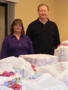 Steve Dannenmann (right) and Cathy Kamosa deliver over 180 gifts to be given to the residents of Bello Machre.