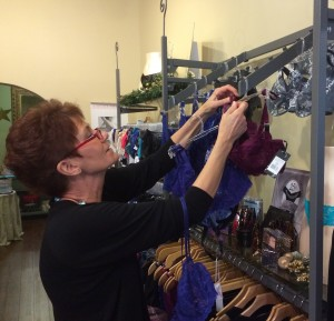 Valerie Wagner, a certified bra fitter at á la mode intimates, checks store stock for sizes. This month, á la mode intimates in the Annapolis Towne Center is offering $5 off a new bra when you turn in a worn or ill-fitting bra.