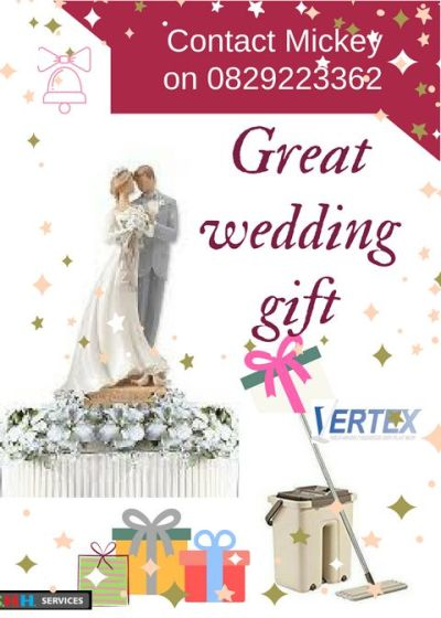 Bridal couple on a cake with Vertex mop amongst wedding gifts in the forefront