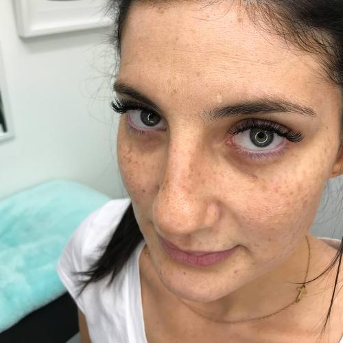 An Eyewonderlust eyelash extensions customer shows off their new lashes.