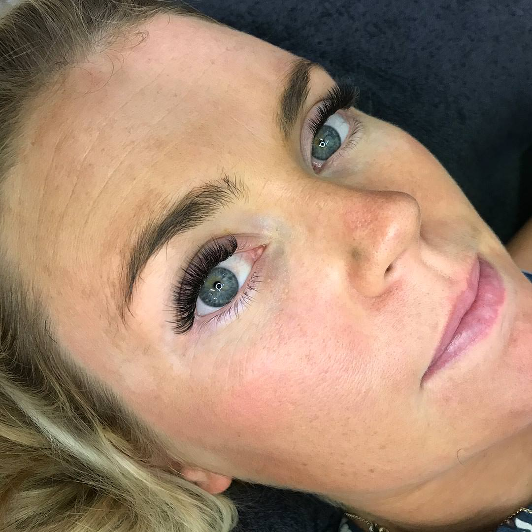 An Eyewonderlust eyelash extensions customer shows off their new lashes. Understanding your eyelash is a key.