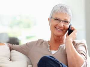 Older woman with glasses on the phone