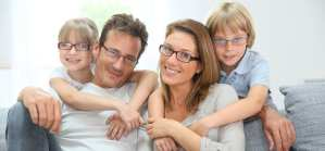 Family with 2 children. All have glasses