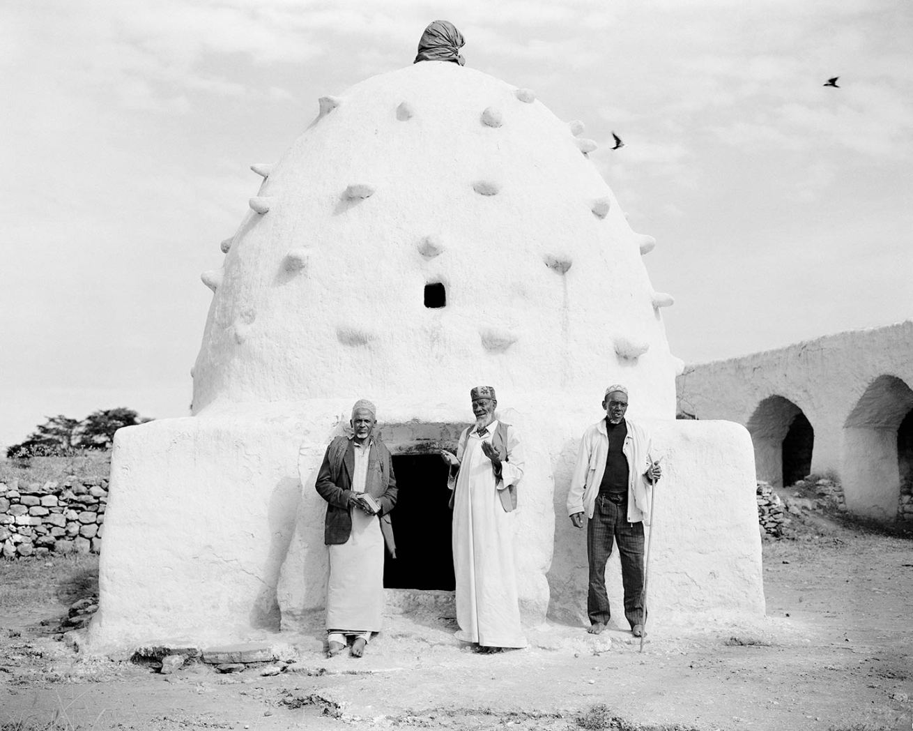 "Dire Sheikh Hussein: in front of Sheikh Abdel Kadir shrine, Sheek Mahmud, Sheek Hassan Salyo & Sheek Abdul-Jabbar. 4x5"" Black & White Film"