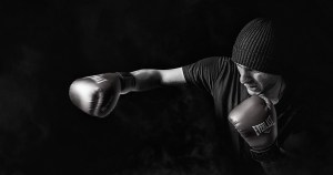 Caucasian man with a beanie on boxing.
