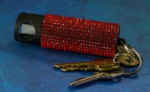 Red pepper spray on a set of keys.