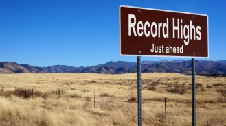 sign with record highs just ahead written on it with dessert in background.