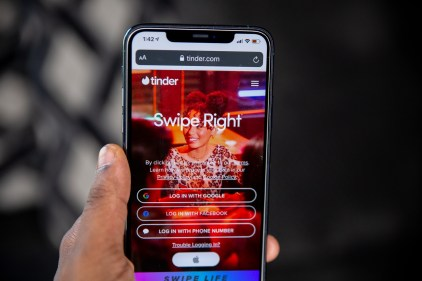 screen with tinder logo in the left corner and swipe right on the middle of the screen