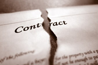 piece pf paper that says contract on it torn in half