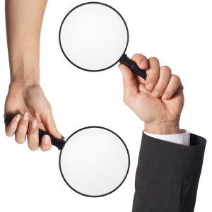 two hands holding a magnifying glass in each hand