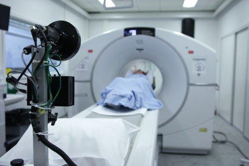 person sitting in a CT scan