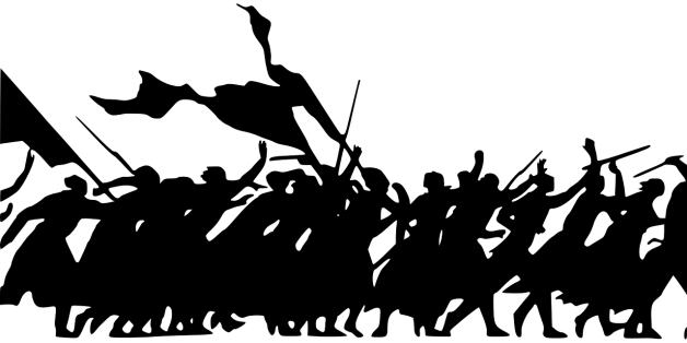 silhouette of people rioting and protesting