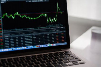 laptop screen with stock market on it