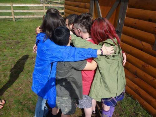 group of kids hugging
