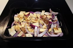 Roast the sweet potato or kumara with the red onion, cumin seeds, and ground coriander