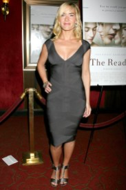 Trying out the fitted dresses - Kate Winslet