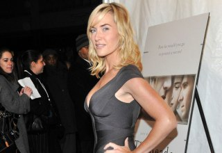 Kate Winslet wearing a grey fitted dress at The Reader premiere
