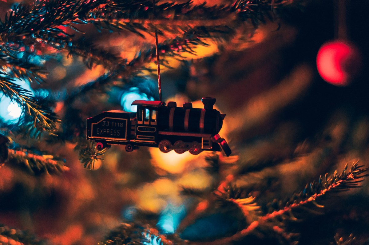 A holiday train floats amidst the Christmas adornments filled with Haps & Hols and other good cheer