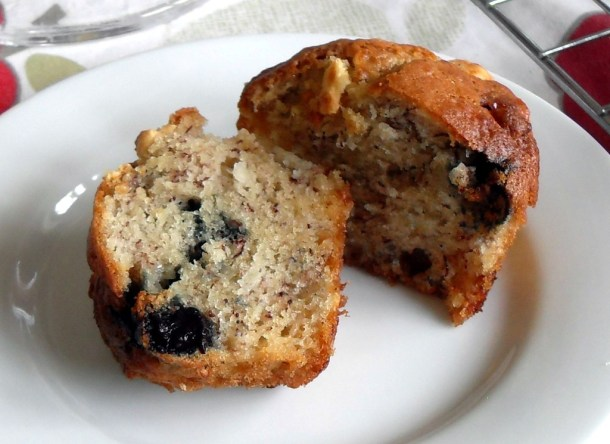 Blueberry, Banana and White Chocolate Muffins - cut in half on a plate.