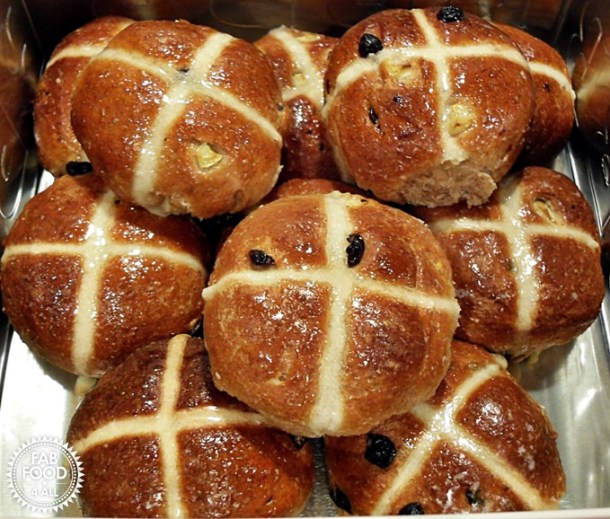 A stack of Wholemeal Apple Hot Cross Buns - fruity & delicious!