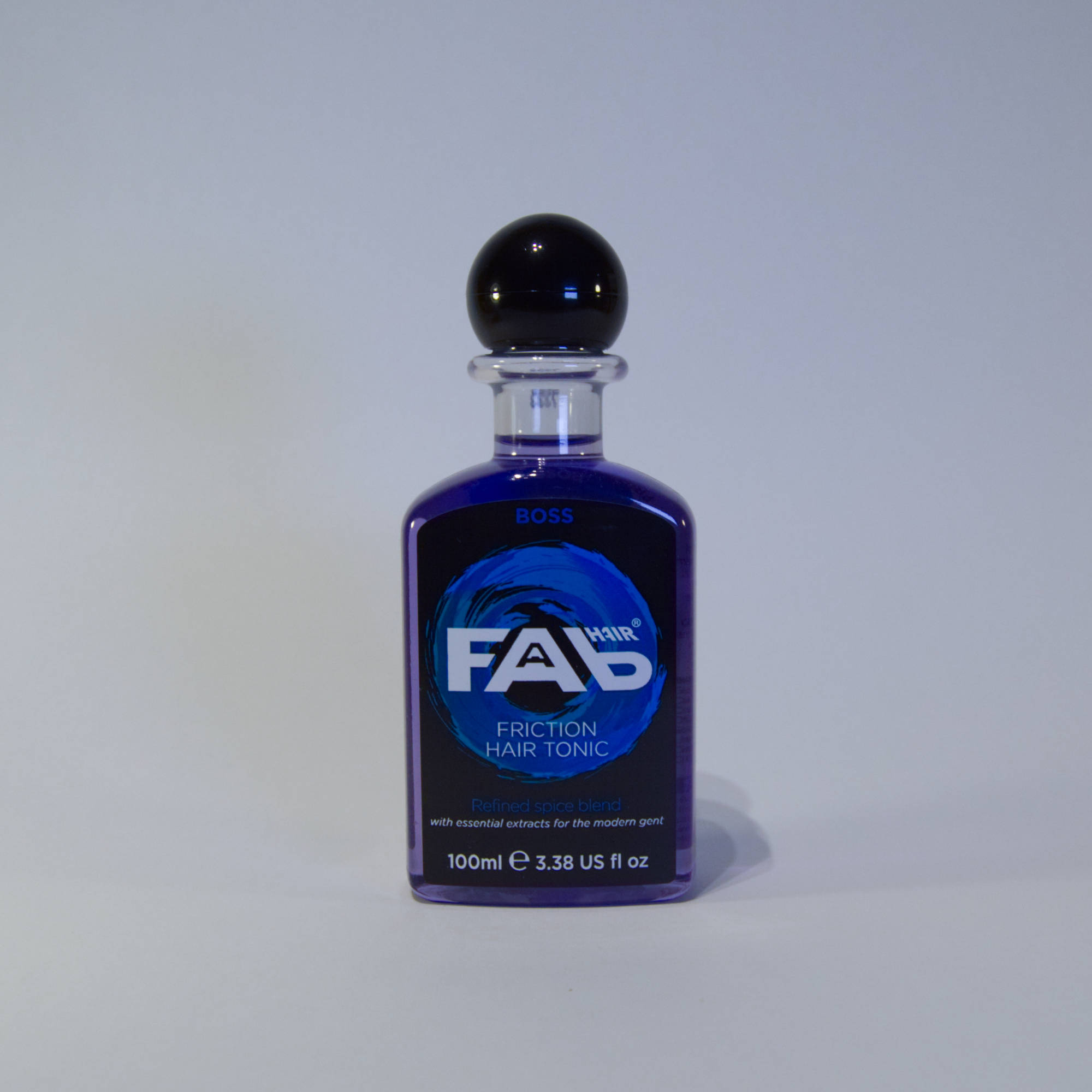 100ml bottle of Boss flavoured FAB friction hair tonic
