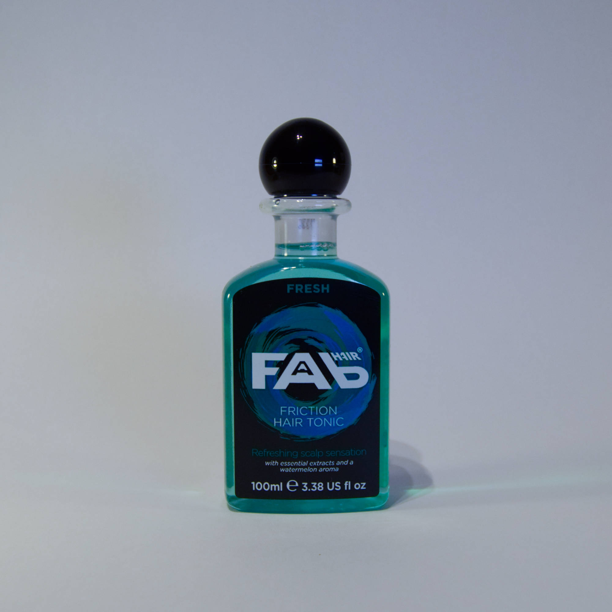 100ml bottle of Fresh flavoured FAB friction hair tonic