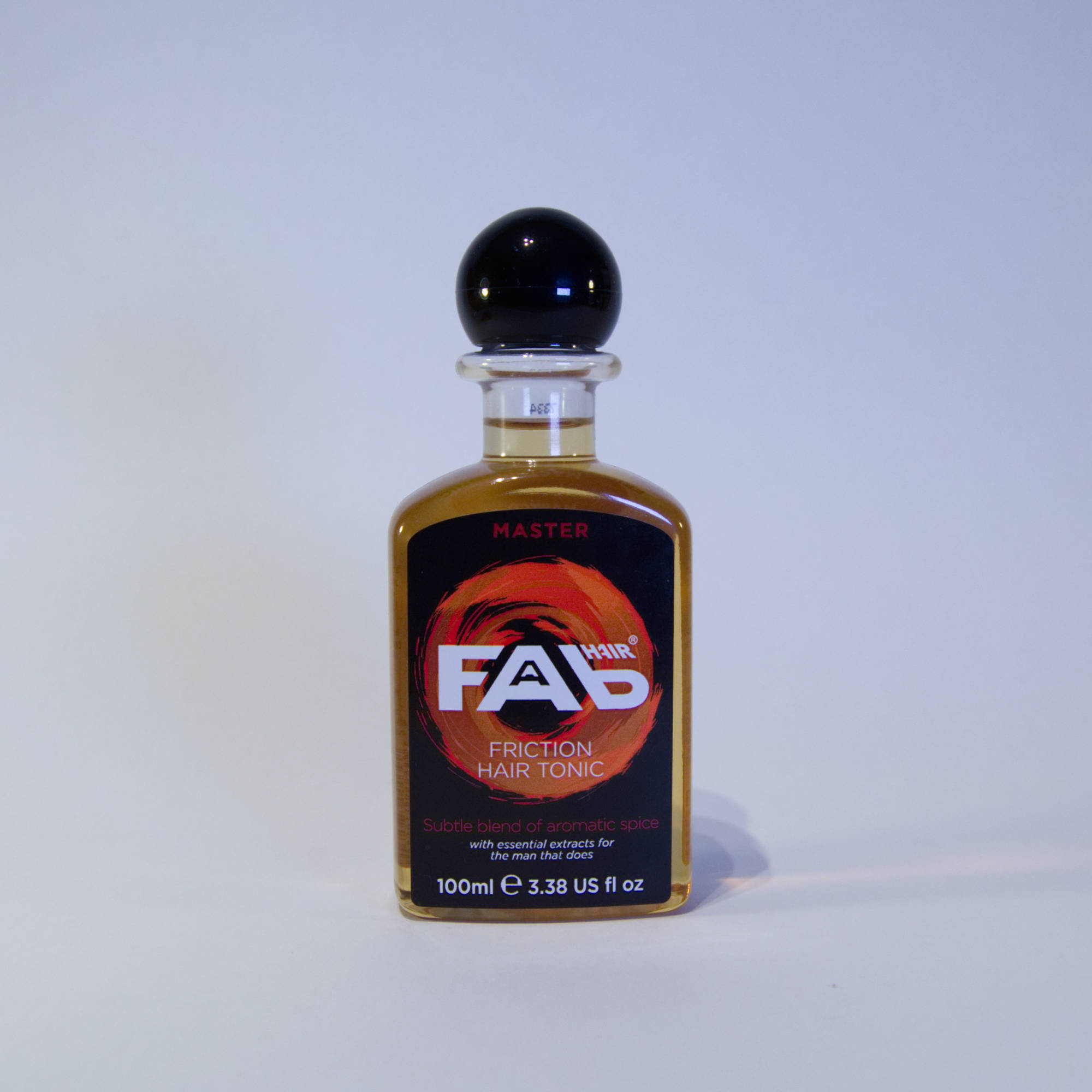 100ml bottle of Master flavoured FAB friction hair tonic