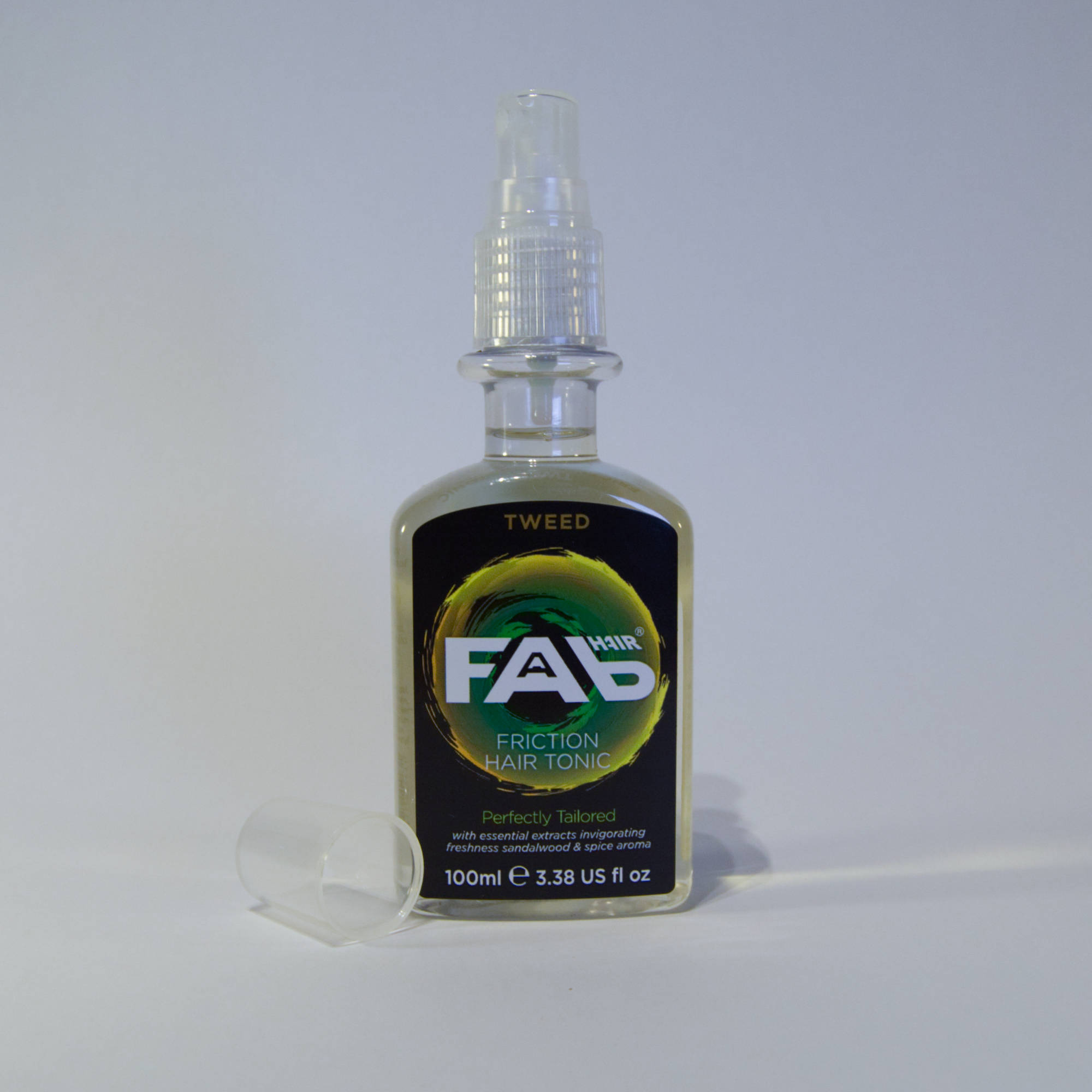 100ml bottle of Tweed flavoured FAB friction hair tonic with Spray Nozzle