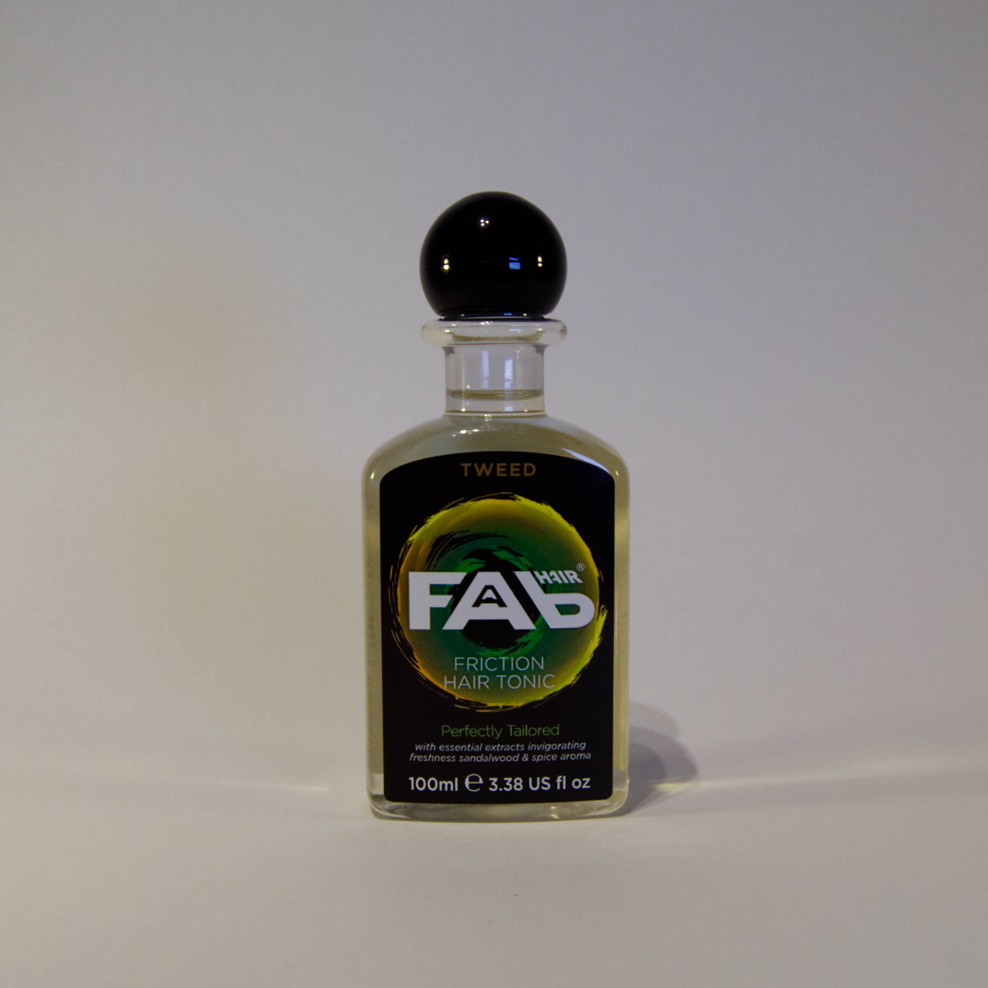 100ml bottle of Tweed flavoured FAB friction hair tonic