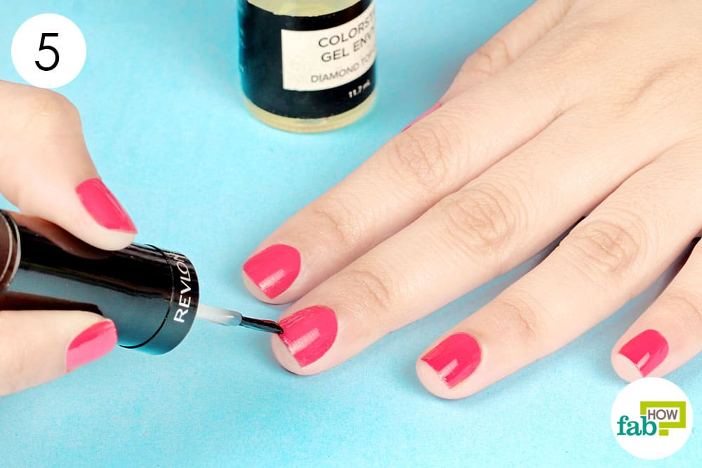 Dip The Brush In Top Coat And Apply It Over Each Nail Using 3 Strokes Keep Very Light To Avoid Digging Into Polish