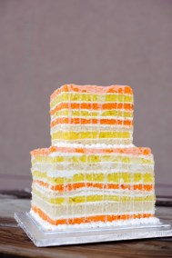 yellow orange naked wedding cake