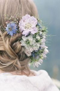 wedding updo hairstyles with blue flowers
