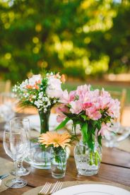 simple wedding centerpieces - wedding reception in The Peach Orchard | Photography : marymargaretsmith.com | https://www.fabmood.com/a-cozy-fall-wedding-in-the-peach-orchard #peach #fallwedding