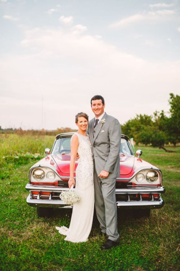 Bride & groom and red getaway car Wedding in The Peach Orchard | Photography : marymargaretsmith.com | https://www.fabmood.com/a-cozy-fall-wedding-in-the-peach-orchard #peach #fallwedding