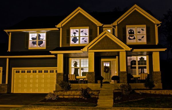 window dressing ideas for living rooms decorating with sectionals windows spooky silhouettes on halloween