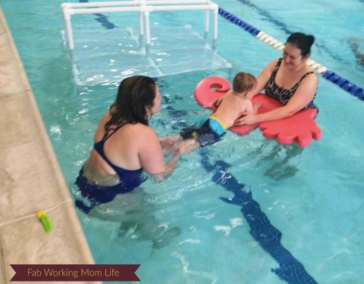 Another photo with our instructor, practicing kicking in the water.