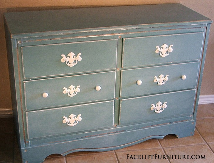 Distressed Sea Blue Dresser with White Glaze & Pulls. Facelift Furniture DIY Blog.